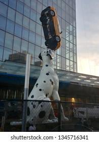 New York, NY - May 21 2018: Sculpture of a dalmatian balancing a taxi outside NYU Hospital
