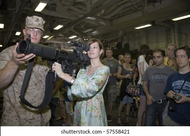 NEW YORK, NY - MAY 23: United States Marinehelps civilian with an M224 weapon.  Photographed during Fleet Week aboard the USS Iwo Jima May 23, 2009 in NYC.