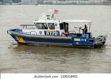 New York, NY - May 28, 2018: NYPD boat crew on guard during Memorial Day celebration at Intrepid Sea, Air & Space Museum