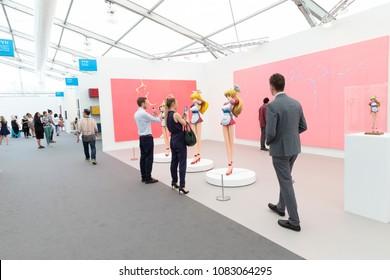 New York, NY - May 3, 2018: Visitors examine art by Takashi Murakami presented by Gagosian Gallery at New York Frieze Art Fair at Randalls Island