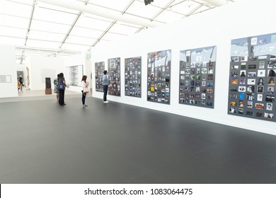 New York, NY - May 3, 2018: Visitors examine art presented by Gavin Brown enterprise at New York Frieze Art Fair at Randalls Island
