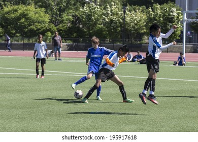 NEW YORK, NY - MAY 31, 2014: South Bronx United 01 team plays against Brooklyn Chernomorets team as part of Cosmopolitan Junior Soccer League Under 12 at Macombs Dam Field the Bronx