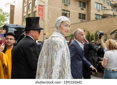 New York, NY - May 6, 2019: Gigi Hadid wearing gown by Michael Kors and Michael Kors leave The Pierre Hotel for Met Gala on theme Camp: Notes on Fashion