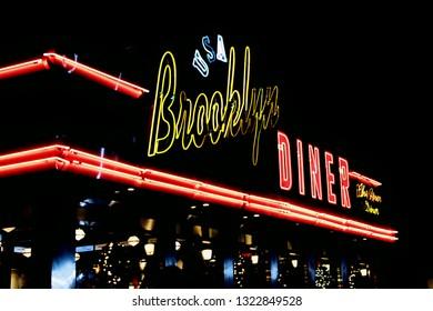New York, NY; Nov 2018 - Midtown Manhattan's Brooklyn Diner's neon lights shine brightly in the night.