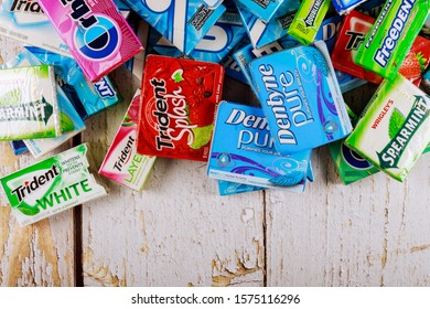 New York NY NOV 29 2019: Various brand of chewing gum in packaging on brands Orbit, Extra, Eclipse, Freedent, Wrigley, Spearmint, Tident, Stride
