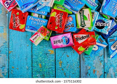 New York NY NOV 29 2019: Various brand chewing gum brands Orbit, Extra, Eclipse, Freedent, Wrigley, Spearmint, Tident, Stride lot of chewing gum packages