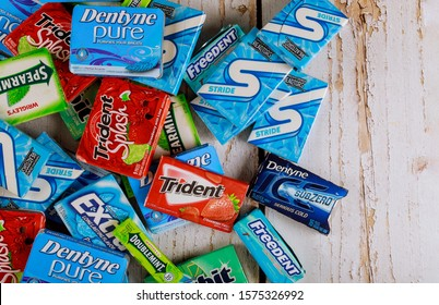 New York NY NOV 29 2019: Various brand chewing gum brands Orbit, Extra, Eclipse, Freedent, Wrigley, Spearmint, Tident, Stride. Ttident, Stride lot of chewing gum packages