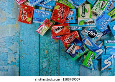 New York NY NOV 29 2019: Various brand chewing gum brands Orbit, Extra, Eclipse, Freedent, Wrigley, Spearmint, Trident, Stride, Stride lot of chewing gum packages