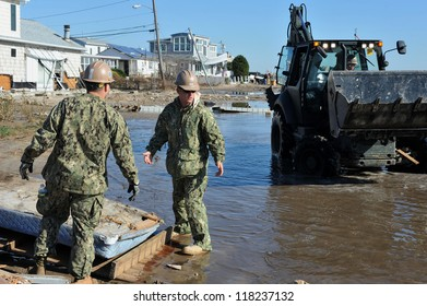 NEW YORK, NY - NOVEMBER 09: U.S. Marines from the 8th Engineer Support Battalion out of NC, move a debris and parts of destroyed houses in the Breezy Point on November 9, 2012 in the Queens of NY.