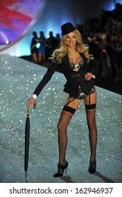 NEW YORK, NY - NOVEMBER 13: Lily Donaldson walks in the 2013 Victoria's Secret Fashion Show at Lexington Avenue Armory on November 13, 2013 in New York City.