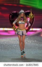 NEW YORK, NY - NOVEMBER 13: Model Ieva Laguna walks the runway at the 2013 Victoria's Secret Fashion Show at Lexington Avenue Armory on November 13, 2013 in New York City.