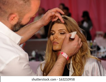 NEW YORK, NY - NOVEMBER 13: Makeup Artist Dick Page applying make-up to model Maryna Linchuk at the 2013 Victoria's Secret Fashion Show at Lexington Avenue Armory on November 13, 2013 in NYC.