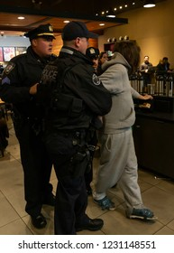 New York, NY - November 15, 2018: Police makes arrest of man for disorderly conduct during heavy snow falls in New York City disrupted evening rush hour commute at Port Authority Bus Terminal