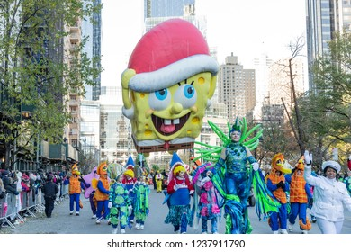 New York, NY - November 22, 2018: SpongeBib SquarePants giant balloon floats at 92nd Annual Macy's Thanksgiving Day Parade on the streets of Manhattan in frigid weather