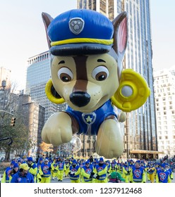 New York, NY - November 22, 2018: Chase by Paw Patrol giant balloon floats at 92nd Annual Macy's Thanksgiving Day Parade on the streets of Manhattan in frigid weather