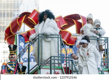 New York, NY - November 22, 2018: Diana Ross and family ride float at 92nd Annual Macy's Thanksgiving Day Parade on the streets of Manhattan in frigid weather