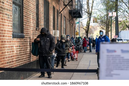 New York, NY - November 24, 2020: People standing in line for distribution of turkeys, groceries and produce by National Guards and Governor Cuomo at NY Common Pantry