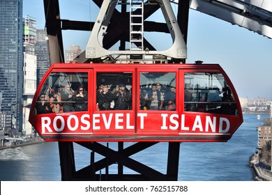 NEW YORK, NY - NOVEMBER 25, 2017: A Roosevelt Island Tramway car is passing by the support tower on a short journey from Manhattan with the East River in view.