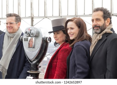 New York, NY - November 27, 2018: Cast & creators of The Marvelous Mrs. Maisel participate in ceremonial lighting of Empire State Building in support of Girls Inc