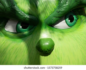 New York, NY - November 28, 2019: Dr. Seuss The Grinch and dog Max giant balloon flown low because of high wind at 93rd Annual Macy's Thanksgiving Day Parade alone Central Park West