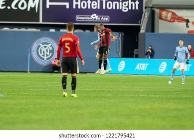 New York, NY - November 4, 2018: Darlington Nagbe (6) of Atlanta United FC & Alexander Ring (8) of NYC FC fight for ball during semifinal 1st leg of Audi MLS Cup at Yankees stadium