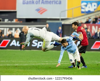 New York, NY - November 4, 2018: Goalkeeper Brad Guzan (1) of Atlanta United FC defends against David Villa (7) of NYC FC during semifinal 1st leg of Audi MLS Cup at Yankees stadium