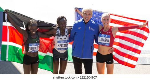 New York, NY - November 4, 2018: Vivian Cheruiyo, Mary Keitany, Peter Ciaccia, Shalane Flanagan celebrate Women's Division during the 2018 TCS New York City Marathon at Central Park