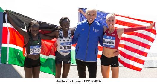 New York, NY - November 4, 2018: Vivian Cheruiyo, Mary Keitany, Peter Ciaccia, Shalane Flanagan celebrate Women's Division during the 2018 TCS New York City Marathon at Central Park