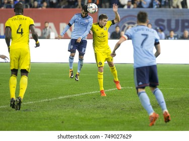 New York, NY - November 5, 2017: Wil Trapp (20) of Columbus Crew & Maximiliano Moralez (10) of NYC FC fight for ball during MLS Cup semifinal 2nd leg at Yankee stadium