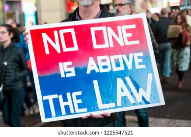 New york, NY - November 8 2018: Protesters take to the streets near times square to march against donald trump in the mueller controversy after sessions got fired. Sign reads: No one is above the law