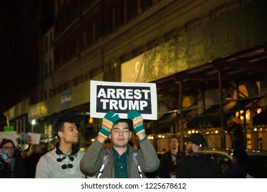 New york, NY - November 8 2018: Protesters take to the streets near times square to march against donald trump in the mueller controversy after sessions got fired. Sign reads: arrest trump