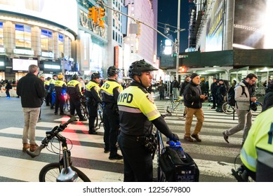 New york, NY - November 8 2018: Protesters take to the streets near times square to march against donald trump in the mueller controversy after sessions got fired. NYPD Biker police in enforcement