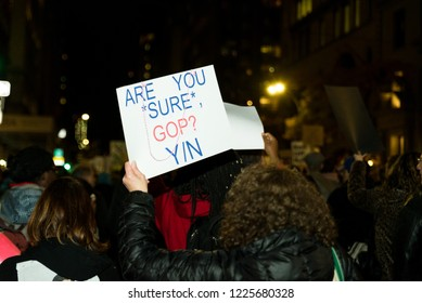 New york, NY - November 8 2018: Protesters take to the streets near times square to march against donald trump in the mueller controversy after sessions got fired. Sign reads: Are you sure? Y/n