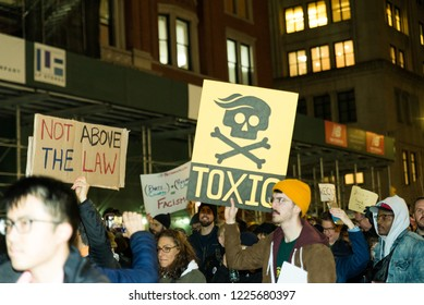 New york, NY - November 8 2018: Protesters take to the streets near times square to march against donald trump in the mueller controversy after sessions got fired. Sign reads: toxic
