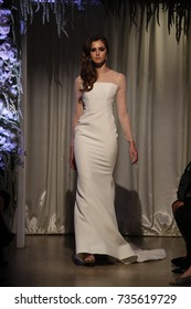NEW YORK, NY - OCTOBER 04: A model walks the runway wearing Matthew Christopher dresses at NY Bridal Fashion Week at Punto Space 325 W 38th street on October 04, 2017 in New York City.