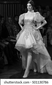 NEW YORK, NY - October 06, 2016: A model walks the runway during the Yolan Cris Bridal Fall/Winter 2017 Runway Show during NY Fashion Week Bridal