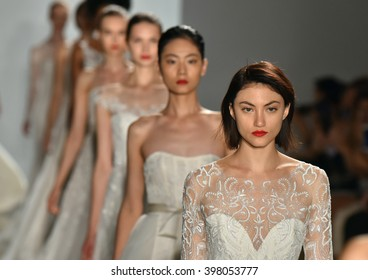 NEW YORK, NY - OCTOBER 09: A models walks the runway during the Amsale Fall/Winter 2016 Couture Bridal Collection runway show on October 9, 2015 in New York City.