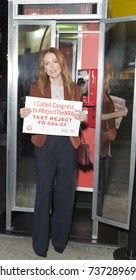 New York, NY - October 18, 2017: Julianne Moore makes phone call at launch campaign calling on Congress to Reject the NRA by Moms Demand Action & Everytown for gun safety at The Standard hotel