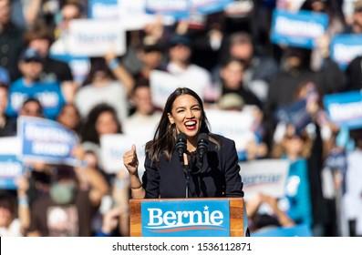 "New York, NY - October 19, 2019: U.S. Representative Alexandria Ocasio-Cortez speaks during Bernie Sanders Rally ""Bernie's Back"" in Queensbridge Park. She endoreses him for President of USA"