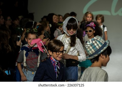 NEW YORK, NY - OCTOBER 19: Models walk the runway finale during the Clarks preview at petitePARADE Kids Fashion Week at Bathhouse Studios on October 19, 2014 in New York City.