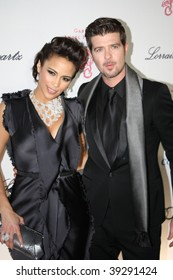 NEW YORK, NY - OCTOBER 20: Paula Patton (L) and Robin Thicke (R) attend the 2009 Angel Ball on October 20, 2009 in New York City.