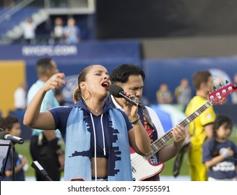 New York, NY - October 22, 2017: YaYa Vargas sings National Anthem with Tito Puerte Jr band before MLS regular game between NYC FC & Columbus Crew SC at Citi Field Game ended in draw 2 - 2
