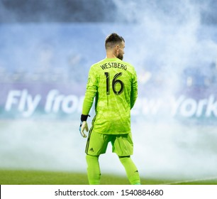 New York, NY - October 23, 2019: Goalkeeper Quentin Westberg (16) of Toronto FC shown through smog during Eastern Conference MLS Audi Cup semifinal against NYCFC at Citi Field Toronto FC won 2 - 1