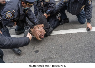 NEW YORK, NY – OCTOBER 25: NYPD Police Officers arrest an Anti-Trump protester for disorderly conduct on October 25, 2020 in New York City.