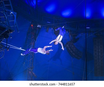 New York, NY - October 29, 2017: Ammed Tuniziani, Mauricio Navas performs Flying Trapeze act at Big Apple Circus opening night at Lincoln Center Damrosch Park