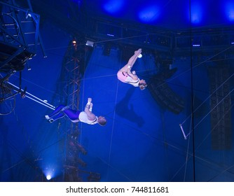 New York, NY - October 29, 2017: Ammed Tuniziani, Estefani Tuniziani performs Flying Trapeze act at Big Apple Circus opening night at Lincoln Center Damrosch Park