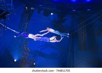 New York, NY - October 29, 2017: Ammed Tuniziani, Adriano DeQuadra, Mauricio Navas performs Flying Trapeze act at Big Apple Circus opening night at Lincoln Center Damrosch Park