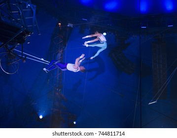 New York, NY - October 29, 2017: Ammed Tuniziani, Adriano DeQuadra performs Flying Trapeze act at Big Apple Circus opening night at Lincoln Center Damrosch Park