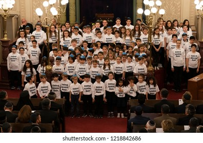 New York, NY - October 31, 2018: Children choir performs during Interfaith service United Against Hate commemorating victims of Pittsburgh shooting at Park East Synagogue