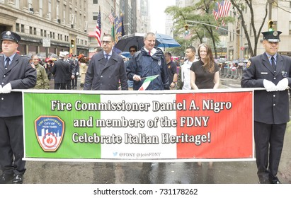 New York, NY - October 9, 2017: Mayor Bill De Blasio & Fire commissioner Daniel Nigro attend Columbus Day parade under rain along Fifth Avenue in Manhattan